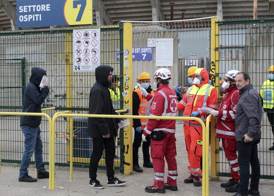 Spectators have their temperature measured as they enter the Via Del Mare Stadium in Lecce, Italy, Sunday, March 1, 2020 prior to the Serie A soccer match between Lecce and Atalanta. (Donato Fasano/LaPresse via AP)