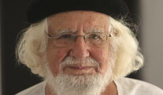 FILE - This Aug. 29, 2008 file photo shows Nicaraguan priest and poet Ernesto Cardenal in his home while under house arrest, in Managua, Nicaragua. Cardenal has died on Sunday, March 1, 2020, according to his personal assistant Luz Marina Acosta. (AP Photo/Esteban Felix, File)