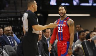Detroit Pistons guard Derrick Rose, right, questions referee Curtis Blair, left, about a foul call during the first half of an NBA basketball game against the Sacramento Kings in Sacramento, Calif., Sunday, March 1, 2020. (AP Photo/Rich Pedroncelli)