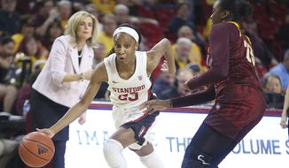 Stanford's Kiana Williams, front left, drives around Arizona State's Iris Mbulito, right, during the first half of an NCAA college basketball game Sunday, March 1, 2020, in Tempe, Ariz. (AP Photo/Darryl Webb)