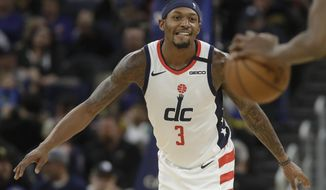 Washington Wizards guard Bradley Beal (3) waits as the Golden State Warriors bring the ball down the court during the first half of an NBA basketball game in San Francisco, Sunday, March 1, 2020. (AP Photo/Jeff Chiu)