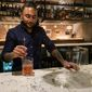 """Ashish Alfred mixes a non-alcoholic, or """"zero-proof,"""" cocktail at the bar of his restaurant George's Chophouse in Bethesda, Maryland. Mr. Alfred is sponsoring sober events at his establishment. (Sophie Kaplan/The Washington Times)"""