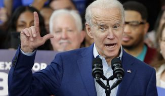 Democratic presidential candidate former Vice President Joe Biden gestures while speaking during a campaign rally Monday, March 2, 2020, at Texas Southern University in Houston. (AP Photo/Michael Wyke)
