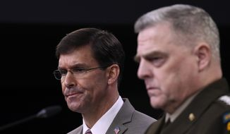 Defense Secretary Mark Esper, left, and Chairman of the Joint Chiefs of Staff Army Gen. Mark Milley, right, during a briefing at the Pentagon in Washington, Monday, March 2, 2020. (AP Photo/Susan Walsh)