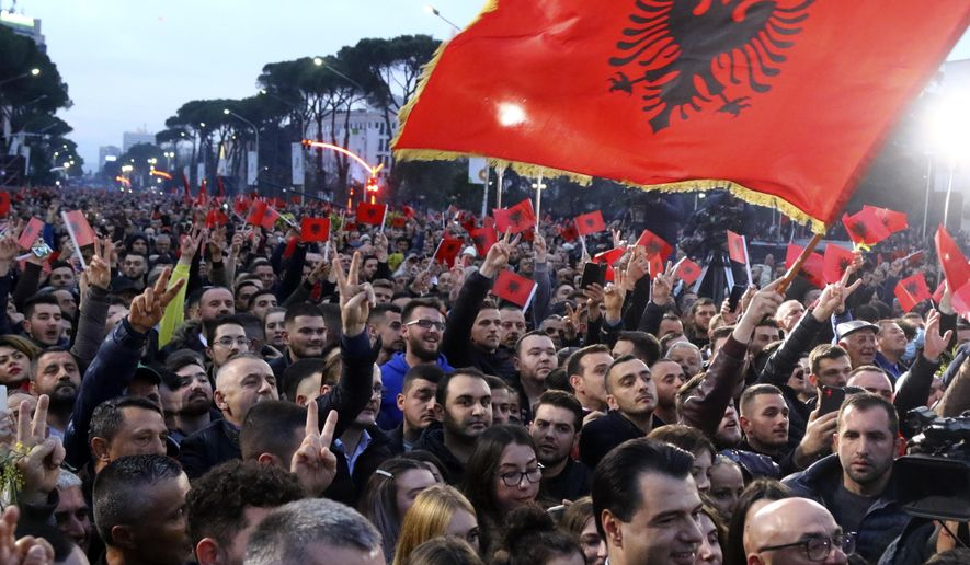 People take part in rally in Tirana, Albania, Monday, March 2, 2020. Thousands of Albanians on Monday responded to a call from the country's president in a rally against the left-wing Socialist Party government he accuses of violating the constitution and of links to organized crime. (AP Photo/Hektor Pustina)