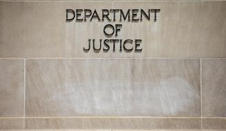 In this June 19, 2015, file photo, the Justice Department Building in Washington is shown. (AP Photo/Andrew Harnik, File) **FILE**
