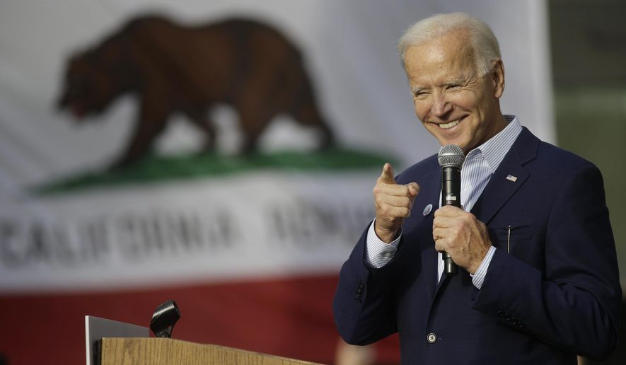 In this Nov. 14, 2019, file photo, Democratic presidential candidate and former Vice President Joe Biden smiles as he holds a campaign rally at Los Angeles Trade Technical College in Los Angeles. (AP Photo/Damian Dovarganes, File)