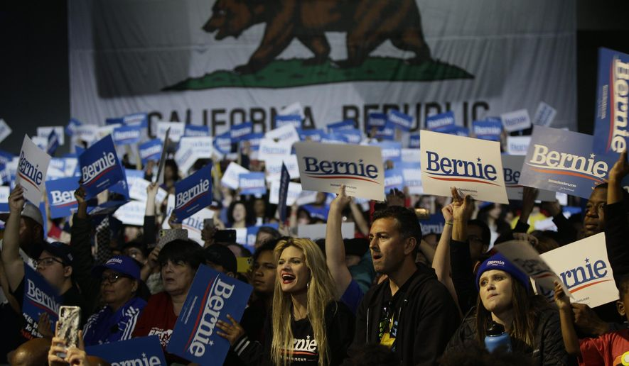 Supporters cheer for Democratic presidential candidate Sen. Bernie Sanders, I-Vt., as he speaks at a campaign event at Los Angeles Convention Center in Los Angeles Sunday, March 1, 2020. (AP Photo/Damian Dovarganes)