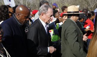 "Democratic presidential candidate Mike Bloomberg walks across the Edmund Pettus Bridge in Selma, Ala., Sunday, March 1, 2020, to commemorate the 55th anniversary of ""Bloody Sunday,"" when white police attacked black marchers in Selma. (AP Photo/Patrick Semansky)"