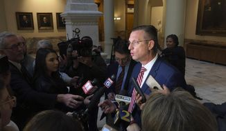 Congressman Doug Collins, R-Ga., speaks to reporters at the Georgia state capital in Atlanta after signing in to qualify for state and federal offices, Monday, March 2, 2020. Georgia's political season kicks into high gear Monday as qualifying for state and federal offices begins. (Bob Andres/Atlanta Journal-Constitution via AP)