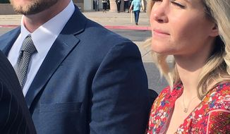 In this Feb. 27, 2020 photo Melani Pawlowski, right, is shown with her husband Ian Pawlowski outside a courthouse in Mesa, Ariz. Her ex-husband has alleged Pawlowski knows the whereabouts of two of her aunt Lori Vallow's two children, who have been missing since September. Pawlowski's lawyers denied the allegation and said their client has cooperated with authorities in the investigation. (AP Photo/Jacques Billeaud)