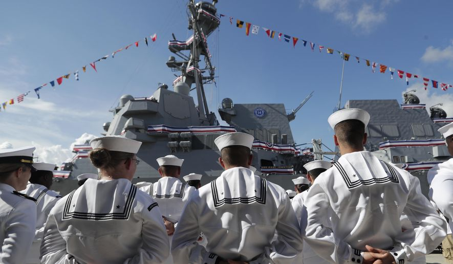 In this Saturday, July 27, 2019, file photo, sailors stand during a commissioning ceremony for the U.S. Navy guided-missile destroyer USS Paul Ignatius, at Port Everglades in Fort Lauderdale, Fla. The U.S. Navy is releasing a strategy that describes plans to overhaul its approach to education because the nation no longer has a massive economic and technological edge over potential adversaries. (AP Photo/Lynne Sladky, File)