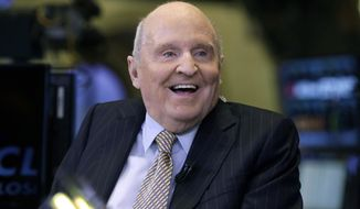 In this Oct. 22, 2013, file photo, former Chairman and CEO of General Electric Jack Welch appears on CNBC on the floor of the New York Stock Exchange. Welch, who transformed General Electric Co. into a highly profitable multinational conglomerate and parlayed his legendary business acumen into a retirement career as a corporate leadership guru, has died at the age of 84. (AP Photo/Richard Drew, File)