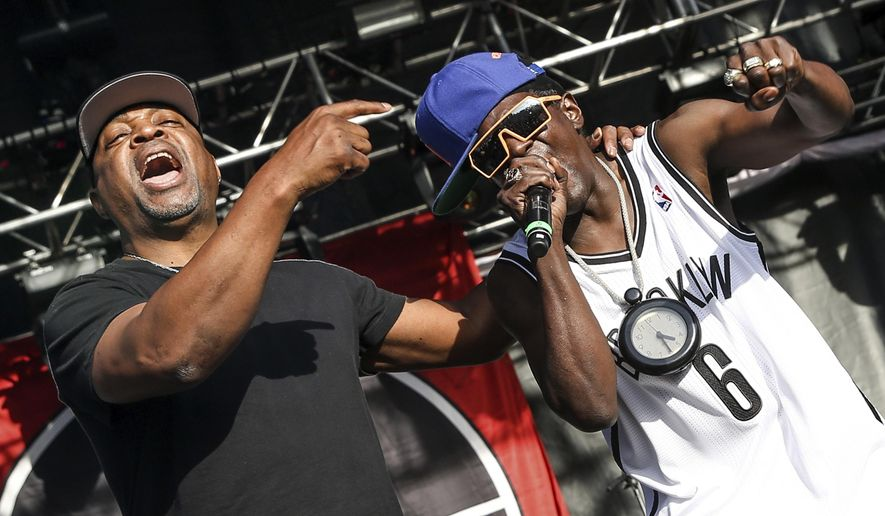 This May 29, 2015 file photo shows Chuck D, left, Flavor Flav of Public Enemy performing at the 2015 BottleRock Napa Valley Music Festival in Napa, Calif. (Photo by Rich Fury/Invision/AP, File)