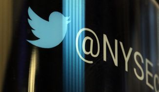 In this Oct. 27, 2016, file photo, the Twitter logo appears on a phone post on the floor of the New York Stock Exchange. (AP Photo/Richard Drew, File)