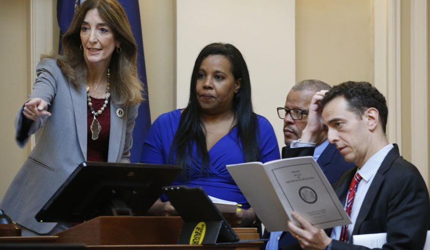 House Speaker Eileen Filler-Corn, D-Fairfax, left, confers with majority leader Del. Charniele Herring, D-Alexandria, second from left, Del. Luke Torian, D-Prince William, second from right, and Del. Marcus Simon, D-Fairfax, right, during the House session at the Capitol Wednesday, Feb. 26, 2020, in Richmond, Va. Virginia Democrats made nonpartisan redistricting a key campaign plank during last year's off-year election, when they won full control of the statehouse for the first time in a generation. Now in power, they may not pass any reform measures because of internal party divisions. (AP Photo/Steve Helber)