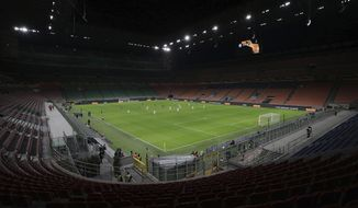 FILE - The seats are empty as a precaution against the coronavirus at the San Siro stadium in Milan, Italy, during the Europa League round of 32 second leg soccer match between Inter Milan and Ludogorets on Thursday, Feb. 27, 2020. (Emilio Andreoli, UEFA via AP, File)