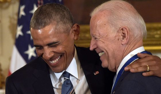 Former president Barack Obama and formver vice president Joe Biden are shown in this undated photo. Mr. Obama is expected to soon formally endorse Mr. Biden, according to a report April 14, 2020. (Associated Press) **FILE**