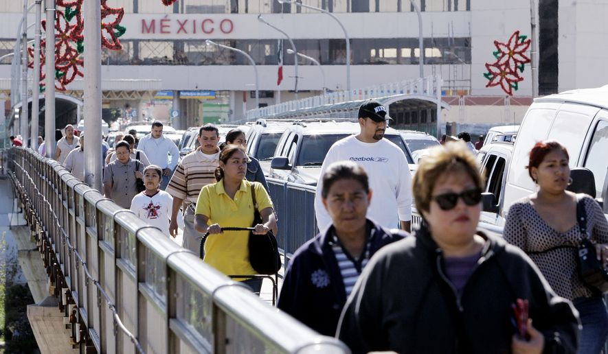 In this Monday, Dec. 3, 2007, file photo, a stream of pedestrians cross the Gateway to the Americas International Bridge from Mexico into the U.S. in Laredo, Texas. (AP Photo/Eric Gay) ** FILE **