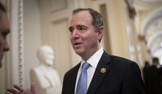 House Intelligence Committee Chairman Adam Schiff, D-Calif., talks to reporters as lawmakers work to extend government surveillance powers that are expiring soon, on Capitol Hill in Washington, Tuesday, March 3, 2020. (AP Photo/J. Scott Applewhite)