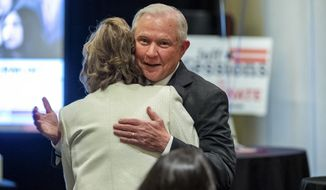 Jeff Sessions visits with supporters prior to his watch-party speech, as he and his supporters watch results come in from Alabama's state primary, Tuesday, March 3, 2020, in Mobile, Ala. (AP Photo/Vasha Hunt)
