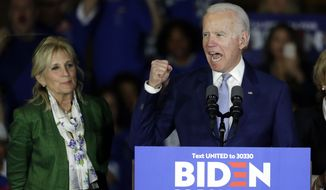 Democratic presidential candidate former Vice President Joe Biden, accompanied by his wife Jill Biden, speaks at a primary election night campaign rally Tuesday, March 3, 2020, in Los Angeles. (AP Photo/Chris Carlson)