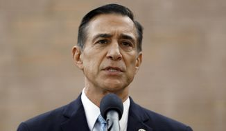 In this Sept. 26, 2019, file photo, former Republican Rep. Darrell Issa speaks during a news conference in El Cajon, Calif. (AP Photo/Gregory Bull, File)