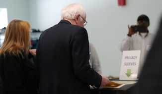 Democratic presidential candidate Sen. Bernie Sanders, I-Vt., and his wife Jane, vote in the Vermont Primary near his home in Burlington, Vt., Tuesday, March 3, 2020. (AP Photo/Charles Krupa)