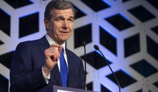 FILE - In this Saturday, Feb. 29, 2020, file photo, North Carolina Gov. Roy Cooper speaks at the Blue NC celebration at the Hilton Charlotte University Place in Charlotte, N.C. North Carolina voters were deciding on Super Tuesday which Democrat they believe can unseat Sen. Thom Tillis and whether the current GOP lieutenant governor is the one best suited to oust Gov. Roy Cooper in the fall. (Joshua Komer/The Charlotte Observer via AP, File)