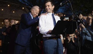 Former Democratic presidential primary candidate Pete Buttigieg endorses Joe Biden, during an event at the Chicken Scratch restaurant the night before Super Tuesday primary voting, on Monday night, March 2, 2020, in Dallas. (Juan Figueroa/The Dallas Morning News via AP) **FILE**