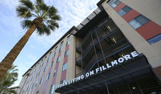 """FILE - In this Wednesday, Dec. 4, 2019, file photo, the main entrance is seen of a new apartment building opened for a ceremony at the Native American Connections Urban Living on Fillmore affordable housing unit in Phoenix. Mayor Kate Gallego on Tuesday, March 3, 2020, is calling for a shared regional response to surging homelessness and lack of affordable housing in and around Phoenix, saying more money and longer term solutions are needed to tackle what she said is """"a crisis situation."""" (AP Photo/Ross D. Franklin, File)"""