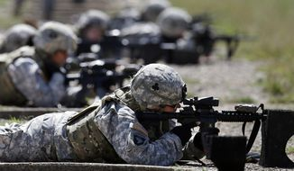 In this Sept. 18, 2012, photo, female soldiers from 1st Brigade Combat Team, 101st Airborne Division train on a firing range while testing new body armor in Fort Campbell, Ky. (AP Photo/Mark Humphrey) **FILE**