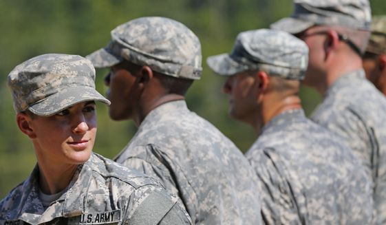 In this Aug. 21, 2015, photo, U.S. Army Capt. Kristen Griest, left, of Orange, Conn., stands in formation during an Army Ranger School graduation ceremony at Fort Benning, Ga. (AP Photo/John Bazemore)  **FILE**