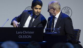 Nasser Al-Khelaifi, left, talks to Lars-Christer Olsson, right, during a meeting of European soccer leaders at the congress of the UEFA governing body in Amsterdam's Beurs van Berlage, Netherlands, Tuesday, March 3, 2020. (AP Photo/Peter Dejong)