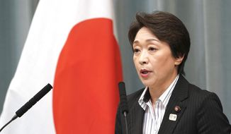 In this Sept. 11, 2019, file photo, then newly appointed Minister in charge of the Tokyo Olympic and Paralympic Games Seiko Hashimoto speaks during a press conference at the prime minister's official residence in Tokyo. Hashimoto's response to a question in the upper house of Parliament on Tuesday, March 3, 2020, implies the Olympics could be held later in the year and would not have to start on July 24, 2020. Tokyo's Olympics are being threatened by a fast-spreading virus that has shut down most sports events and Olympic-related events in Japan. (AP Photo/Eugene Hoshiko, File)