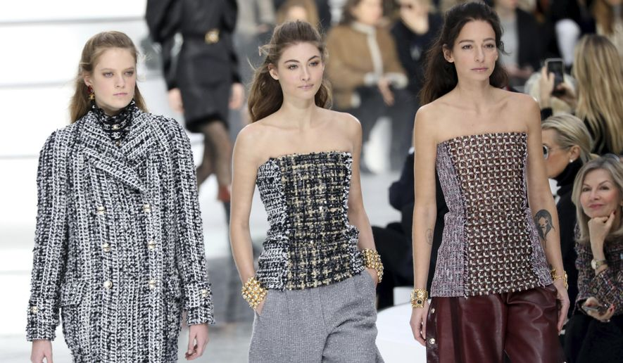 Models wear creations for the Chanel fashion collection during Women's fashion week Fall/Winter 2020/21 presented in Paris, Tuesday, March 3, 2020. (Photo by Vianney Le Caer/Invision/AP)