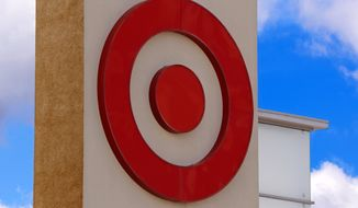 FILE- This May 3, 2017, file photo shows the Target logo on a store in Upper Saint Clair, Pa. Target reported strong fourth-quarter profits, though its sales were weighed down by weak toy and electronics sales during the crucial holiday shopping season.  Target joins a string of other retailers, including Walmart, with disappointing sales during the shortest holiday shopping period since 2013. (AP Photo/Gene J. Puskar, File)