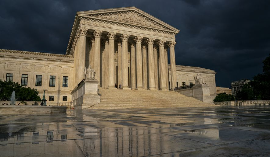 FILE - In this June 20, 2019 file photo, the Supreme Court is seen under stormy skies in Washington. The Supreme Court is taking up the first major abortion case of the Trump era, an election-year look at a Louisiana dispute that could reveal how willing the more conservative court is to roll back abortion rights. (AP Photo/J. Scott Applewhite, File)