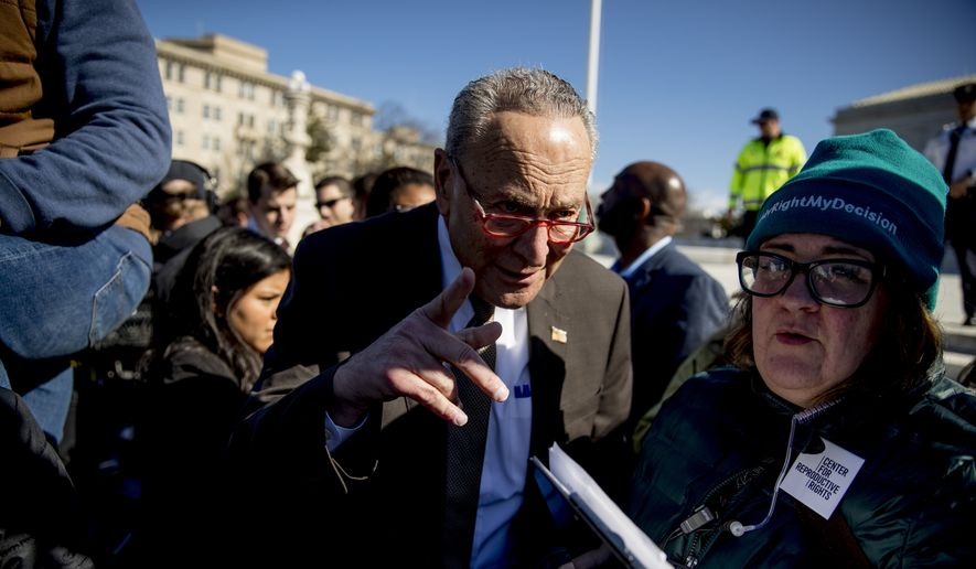 Senate Minority Leader Sen. Chuck Schumer of N.Y. arrives to speak to abortion rights demonstrators at a rally outside the Supreme Court, in Washington, Wednesday, March 4, 2020, as the court takes up the first major abortion case of the Trump era Wednesday, an election-year look at a Louisiana dispute that could reveal how willing the more conservative court is to roll back abortion rights. (AP Photo/Andrew Harnik)
