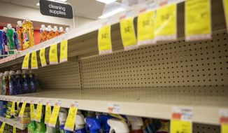 Shelves where disinfectant wipes and sprays are usually displayed sit empty in a pharmacy Wednesday, March 4, 2020, in Providence, R.I., as confirmed cases of the coronavirus rise in the U.S. (AP Photo/David Goldman)