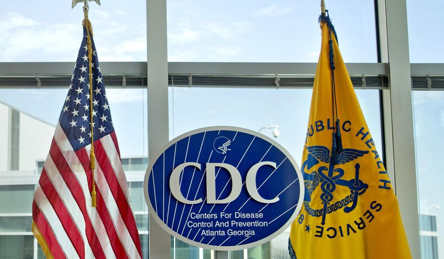 This Nov. 19, 2013 file photo shows a Centers for Disease Control and Prevention logo at the agency's federal headquarters in Atlanta. The CDC warns that the new UK variant of the coronavirus may become the dominant strain in the United States by March 2021. (AP Photo/David Goldman, File)  **FILE**