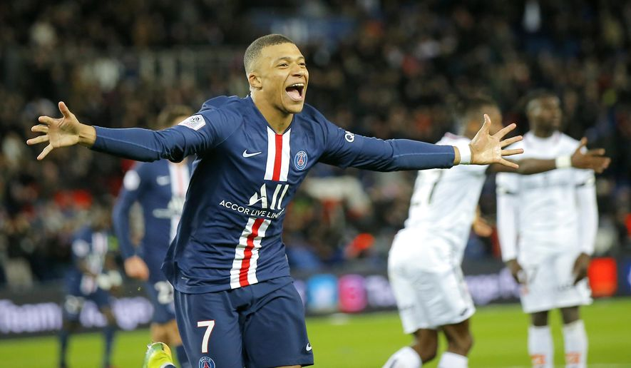 PSG's Kylian Mbappe celebrates after scoring his side's fourth goal during the French League One soccer match between Paris-Saint-Germain and Dijon, at the Parc des Princes stadium in Paris, France, Saturday, Feb. 29, 2020. (AP Photo/Michel Euler)