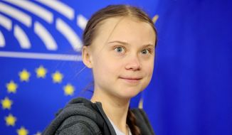 Swedish climate activist Greta Thunberg arrives for a meeting of the Environment Council at the European Parliament in Brussels, Wednesday, March 4, 2020. (AP Photo/Olivier Matthys) ** FILE **