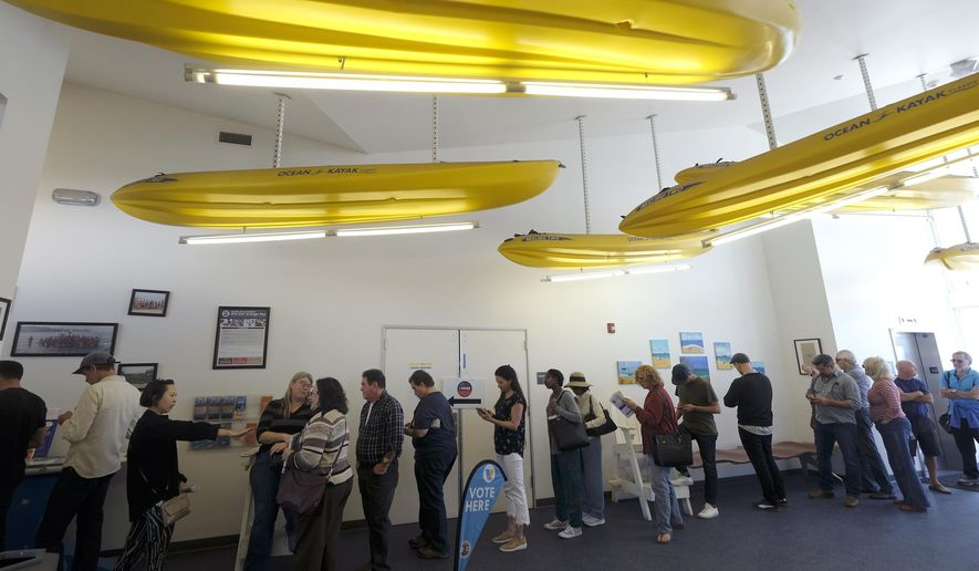 Voters wait in line to cast their ballots at a voting center during the state's Super Tuesday primary election in El Segundo, Calif., Tuesday, March 3, 2020. (AP Photo/Ringo H.W. Chiu)
