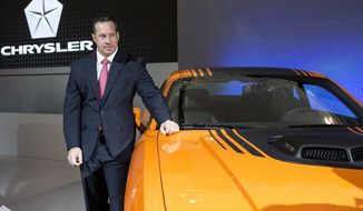 FILE - In this Feb. 13, 2014 file photo,  Reid Bigland unveils the Dodge Challenger Shaker at the Canadian International Auto Show in Toronto.  Fiat Chrysler's head of U.S. sales is leaving the automaker after more than two decades.  Bigland had a bumpy career that saw huge growth but also a whistleblower lawsuit over a scheme to pay dealers to report fake sales numbers. The Italian-American company says Bigland will leave April 3, 2020.  (AP Photo/The Canadian Press, Chris Young, File)
