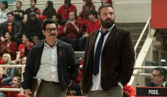 """This image released by Warner Bros. Pictures shows Al Madrigal, left, and Ben Affleck in a scene from """"The Way Back."""" (Richard Foreman/Warner Bros. Pictures via AP)"""