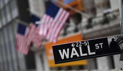 This Jan. 31, 2020, file photo shows a Wall Street sign in front of the New York Stock Exchange. (AP Photo/Mark Lennihan, File)