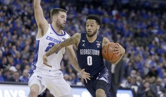 Georgetown's Jahvon Blair (0) drives around Creighton's Mitch Ballock (24) during the first half of an NCAA college basketball game in Omaha, Neb., Wednesday, March 4, 2020. (AP Photo/Nati Harnik)