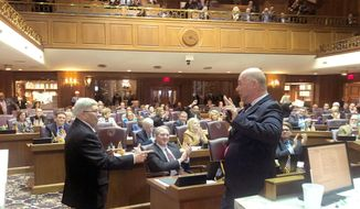 Rep. Patrick Bauer, D-South Bend, left, and Republican Indiana House Speaker Brian Bosma jokingly react after Bosma spoke Wednesday, March 4, 2020, honoring Bauer at the Statehouse in Indianapolis. Bauer is retiring after a 50-year lawmaker career that's made him the longest-serving member in the Indiana Legislature's history. Bauer's tenure was highlighted by his six years as House speaker between 2002 and 2010. (AP Photo/Tom Davies)