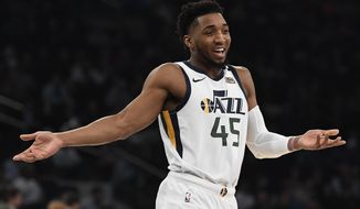 Utah Jazz guard Donovan Mitchell (45) reacts during the first half of the team's NBA basketball game against the New York Knicks in New York, Wednesday, March 4, 2020. (AP Photo/Sarah Stier)